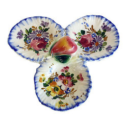 "Italian Ceramic Serving Dish - Take your famous Italian cooking to a whole new level with zero effort. This gorgeous, authentic Italian serving dish proves that you ""eat with the eyes first."" The trefoil shape and hand-painted floral design are straight out of nonna's kitchen — delicate and classic at the same time. What delights will you serve in this dish?"