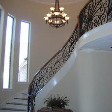 Mediterranean Staircase by Peterson Homebuilders, Inc.