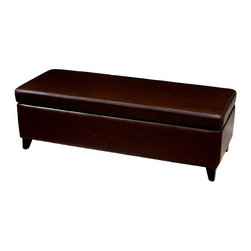 Wholesale Interiors - Leather Bench Ottoman (Dark Brown) - This is a long ottoman that can be used as a comfortable bench as well as a storage ottoman. This bench ottoman provides seating arrangement that can also be used in as an extension of an existing sitting arrangement. This elegant ottoman also provides styles and room to keep items out of sight yet close at hand to meet both your decorative and storage needs. Sturdy construction consisting of kiln dried hardwood frame, with high density foam padding and hinged lid for easy opening and closing. Durable polyurethane coated leather upholstery for longer lasting use and stain resists for easy clean up. Leg constructed with solid rubber wood with veneer finish completes with elegant smooth, clean lines design. The perfect combination of quality craftsmanship with simple and sophisticated designs, that will instantly enhance any room decor.