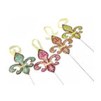 Set of 4 Colorful Metal Fleur de Lis Garden Stakes - These cheerful fleur de lis accents brighten your day in a variety of ways. Use them as stakes in large planters, flower beds, or gardens, display them as hanging ornaments, or simply hang them on the wall. Made of metal, each measures 6 1/4 inches high, 5 1/4 inches wide, and has glitter accents. The included stakes are 13 inches long, and each fleur de lis is threaded with a sheer yellow ribbon hanger. They are a great addition to your porch or patio, and they make a great housewarming gift.