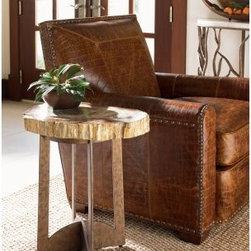 Tommy Bahama by Lexington Home Brands Road to Canberra Adderley Lamp Table - Natural elements – indeed, we're quite confident in saying that the Road to Canberra by Tommy Bahama Home Adderley Lamp Table has natural elements galore. Ideal for an end lamp, potted plants, magazines or books, this little table has big character. On top it features a petrified wood base with natural characteristics. The shape ranges from round to elliptical, and is so unique that we can't give a specific dimension. Because each table is crafted with its own, special piece of petrified wood, the space ranges from 15 to 22 inches. Down under this Aussie-themed table is a durable metal base constructed in rustic bronze, giving it that rugged outback feel that Tommy Bahama intended for this lively collection.About Lexington Home BrandsIf you're looking for respect in the furniture industry you will find plenty of when it relates to Lexington Home Brands. Based in High Point, N.C., with showroom facilities in High Point and Las Vegas, Lexington Home Brands was founded in 1903 and for the past 110 years has garnered respect and trust in an industry that has always been very competitive. Lexington – a global manufacturer and marketer of distinctive home furnishings, and an industry leader in innovative design and lifestyle marketing – built that reputation on design leadership and exceptional value. Lexington's award-winning product line of wood and upholstered furniture encompasses a wide range of designs and styles, with recognized brands like Lexington, Tommy Bahama, Sligh, and Henry Link Trading Co.