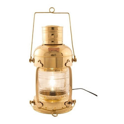 """Handcrafted Model Ships - Brass Anchor Electric Lantern 20"""" - Brass Electric Lantern - This brass anchor electric lantern 20"""" is a beautiful handcrafted production of heavy brass cast hardware. This lanterns provides fantastic emergency lighting or like their oil wick counterparts, these electric lanterns can provide historic and authentic nautical decor. There is a thick clear glass lens which shows an illuminated arc of 225 degrees. Each contains an interior corrugated silvered brass reflector. The oil burning pot and wick unit that was serviced from the bottom of the lanterns has now been converted into an electric fixture. There is room inside for a full size 40w light bulb. Some the applications that our electric lanterns have been used for include, wall lanterns, outdoor lanterns, ships wheel chandeliers, exterior lighting, ceiling fixtures and end table lamps. They also make perfect patio/deck electric lamps. You can also choose to mount them on your wall or post. The back is fitted with one thick cast brass mounting bracket which is riveted to the body of the lamp for extra support. All hardware is included. They are of -Solid brass construction, not to be confused with the cheaper painted or plated varieties. Ideal gifts for people who love nautical lamp memorabilia."""