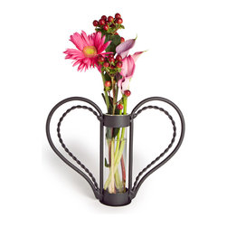 Danya B. - Iron Heart-shaped Sweetheart Flower Vase - Show the strength of your love with this rustic iron sweetheart-shaped vase. The removable, recycled glass cylinder makes cleaning a snap, and the curves of the heart create useful handles. Love is more than just words, and this lovely vase is a creative way to bring your feelings into the physical world.
