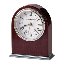 Howard Miller - Howard Miller Walker Alarm Clock - Howard Miller - Alarm Clocks - 645480 - This contemporary table clock has a radiant character and will be an attractive fixture on any mantel or table top. Distinguished by its polished nickel dial bezel and base and classic white dial, the Walker has a real gleam to it. Beautiful hardwood framing in a rosewood finish and quality quartz movement operation complete the look and appeal of this accent clock.