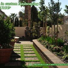 Traditional Landscape by CHIP-N-DALE'S CUSTOM LANDSCAPING