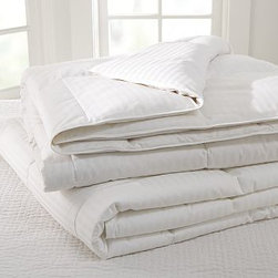 Classic Micromax(TM) Comforter, King/Cal. King - An exceptional value, this comforter is the perfect year-round layer, providing just the right coziness in both the warmer and cooler months. Micromax down alternative. Mid-weight fill for year round comfort. 300-thread-count cotton damask-stripe cover. Finished with end-to-end box quilting. Machine washable. Made in the USA of imported materials.