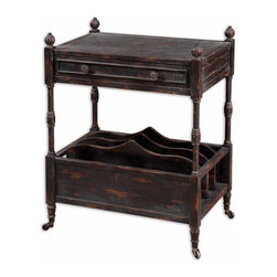 Uttermost - Uttermost Phineas Magazine Table - Painted slate black with red undertones and rub-through distressing. Table has four vertical slots for books, French dovetail drawer, carved finials, and antiqued casters.