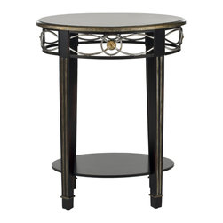 Safavieh - Debra Side Table - An instant classic, the tall and refined Debra side table boasts a dramatic profile with its fluted legs and round top with rubbed edges for a vintage look. A veneer top and iron apron punctuated by brass details lend just enough weight to make Debra a solid addition to any room.