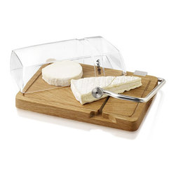 Boska Holland Petit Paris Cheese Cutting Board - How very French! Use this beautiful oak board with an integrated cutting wire and plastic dome to cut, store and display fine cheeses. Made from European white oak and a stainless steel wire blade ideal for slicing soft to semihard cheese. Refrigerator safe, spare wires included. Magnifique!  Dimensions: 12.2 x 7.7 x 1 inches.  Weight: 3 pounds. Made by Boska Holland. 3 spare cutting wires included.  Handwash