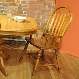 Other Brands - Yorkshire Dining Arm Chair - Burnished Oak Multicolor - 7000-03-A - Shop for Dining Chairs from Hayneedle.com! A winning choice for style and quality the Yorkshire Dining Arm Chair Burnished Oak features a classic arrow back design and durable wood frame that s been beautifully finished in a warm and hospitable burnished oak. The curved back slanted turned legs and leg stretchers provide sturdy support and prolonged comfort for both everyday dining and special festive occasions.