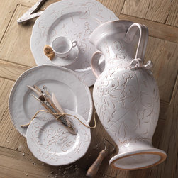 Embossed Fruit Decor - An engraving technique dating back to the 1600's is used to capture this enchanting old world look that coordinates beautifully with Bellezza. The Embossed Fruit collection includes salad plates, serving bowl, platter, vase, and planter. Handcrafted in Tuscany of terra cotta. Microwave and dishwasher safe.  By Vietri.