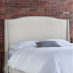"""Skyline Furniture - Nail Button Linen Wingback Headboard - This wingback headboard sets a modern feel with its unique design. It's upholstered in soft linen and embellished with ornamental nail buttons along the silhouette. It's guaranteed to be a focal point of any bedroom. Attaches to any standard bed frame. Features: -Nail Button collection. -Frame material: Solid pine. -Polyurethane and polyester fill foam. -Spot clean only. -1 Year limited warranty, excludes fabric. -Made in the USA. Dimensions: -Full: 55.5"""" H x 59.5"""" W x 9.5"""" D, 48 lbs. -Queen: 55.5"""" H x 65.5"""" W x 9.5"""" D, 50 lbs. -King: 55.5"""" H x 81.5"""" W x 9.5"""" D, 58 lbs. -California King: 55.5"""" H x 77.5"""" W x 9.5"""" D, 53 lbs."""
