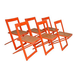 """Pre-owned Mid-Century Italian Red Lacquer Folding Chairs - Seller says: """"I purchased these chairs at my local flea market in the Marais when I was living in Paris a few years ago and shipped them back to the States, where they've been in storage ever since.""""      They are Italian, probably from the early 1970's and have only minimal paint loss on the edges.  All of the cane seats are strong and intact and there is only one chair (see pictures) that needs a little glue.  They all open and close easily. The color is red with orange undertones--a bit more like persimmon than lipstick red."""