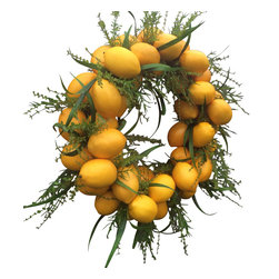"""XL Uptown Faux  Lemon Wreath - Add a touch of elegance to your home with this luscious Lemon Wreath. Its bursting with faux lemon and greens. This simply stunning lemon wreath is made on a grapevine base, with its lemons that are carefully nestled within its base and greenery for a gorgeous wreath that may be hung all year long. This wreath make for a beautiful touch to any home decor inside and out! It measures approx. 22"""" in diameter (up to 25"""" with loose longer greenery) and is approx. 9"""" in depth. It perfect for that zest of color that every home should have!"""