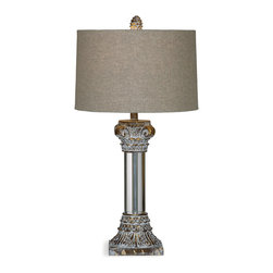 Bassett Mirror - Corinth Table Lamp - A Greek inspired table lamp that will compliment a transitional or traditional space in your home. With it's antique gold lucite finished column base and beige drum shade, this piece will add a timeless elegance to your home decor.