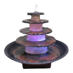 Welland - 5 Tier Stacked Slate Stone Design Tabletop Fountain - This tabletop fountain features a five tier pyramid of realistic stacked slate stone with an underwater changing LED light illuminating the water flow. Made of a durable Slate. What's more, Changing LED lighting makes for beautiful nighttime display, creating a beautiful focal point for your home. Includes pump and underwater Changing LED light.