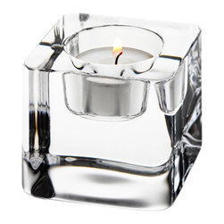 Orrefors - Ice Cube Votive - The inspiration and name for this charming votive doesn�t get any simpler. Ice Cube looks, well, like a king-size ice cube, scooped out with a little hollow for the votive. Fire and ice! Designed by