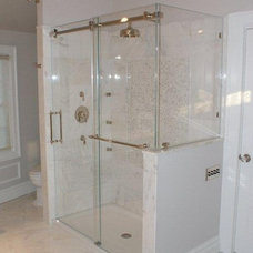 Contemporary Showerheads And Body Sprays by OASIS SHOWER DOORS