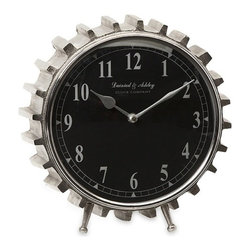 "IMAX - Carlton Table Clock - Gearheads everywhere will love this aluminum table clock. With its black face and clean lines, the gear tooth framing makes this clock perfect for an industrial or urban loft decor. Item Dimensions: (9.75""h x 9.5""w x 4.5"")"