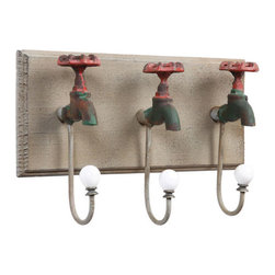Hang Up the Faucet Wall Mount - With the Hang Up the Faucet Wall Mount, you can hang your coats or towels with ease.  Made of iron, this piece is as sturdy as one your grandparents might have owned, but designed with a twist.  The 3 hooks are formed from iron faucets, adding a vintage-like splash to your doorways or bathroom.  Whether you use it to hang towels in your bathroom or coats by your back door, this piece will ensure that great conversation flows from all your guests.
