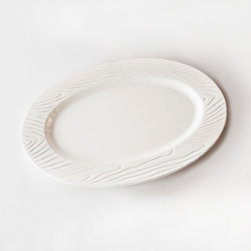 Ceramic Oval Platter - Arrange mini-gourds, sweets and other finger food on this Ceramic Oval Platter. With its organic shape, woodgrain detail and versatile neutral hue, the dish is sure to become one of the most used items at the fall table this season.