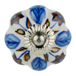 Knob Lovers - Carmen Knob - Take a step into your backyard with the Carmen knob. This white ceramic knob features hand painted leaf designs in blue and dark brown giving off a natural and earthy feel. Carmen is set upon a silver mount and topped with a silver cap.