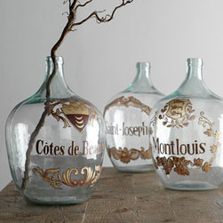 Wine Jug Vases - One big thing is better than many tiny things when it comes to accessorizing your rooms. These fabulous glass wine jugs are dramatic and unusual. Fill one with a large faux floral arrangement, or group three of them together to make a strong design point on a table behind a sofa. I promise, you will instantly see what I mean.