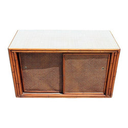 Pre-owned Mid-Century Bamboo Console - We adore this unusual Mid-Century real bamboo and caning embellished sliding door table.  This commode has a mica top and one shelf inside. All four doors slide for 2 sided access, optimum storage and accessibility.