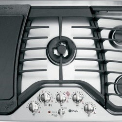 "GE Profile - PGP986SETSS 36"" Gas Cooktop with 5 Sealed Burners  20 000 BTU Tri-Ring Burner  P - The GE PGP986SETSS gas cooktop features a deep-recessed design a 20000 BTU tri-ring burner a Precise Simmer burner and a cast-iron griddle accessory The knobs are backlit to indicate when burners are on and both the knobs and the heavy-cast grates ar..."