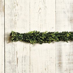 "Ballard Designs - Preserved Boxwood Garland - Coordinates with our Preserved Boxwood Wreath and Mini Wreaths. Garland has jute loop hangers. 65"" Long. Extra thick and full, our Boxwood Garland is hand crafted of real boxwood that's been specially preserved to keep its deep emerald green color season after season. Use alone or add our Petite Starry Lights Garland (sold separately) to dial up the sparkle.Preserved Boxwood Garland features: . . ."