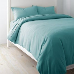Garnet Hill - Garnet Hill Solid Jersey-Knit Crib Fitted Sheet - Crib - Fitted - Turquoise - This cozy combed-cotton jersey-knit bedding is knit of fine yarns for softness, and has a tighter construction than most for a smoother, more substantial feel. Dress your bed with the casual style and comfort of a favorite T-shirt. This higher-quality knit bedding looks great wash after wash, and won't twist on the mattress. A great year-round sheet. Clean double-stitched finish. Fitted sheet is fully elasticized for a better fit. 12-inch pocket depth.