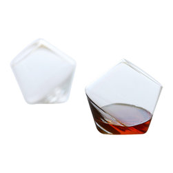 Sempli - Cupa - Rocks - This set of two hand blown Cupa tumblers can enhance the sensory pleasure of drinking brandy or whiskey. The contemporary glasses create a swirling rotation when set down, which assists the oxygenation of your fine spirit and promotes an aromatic experience for the drinker. Constructed to fit perfectly in your hand, the glass naturally works to warm your beverage. Made of lead-free crystal and inspired by Swedish and Italian design, these stunningly styled tumblers were featured in Esquireâs signature space, Esquire House LA 2010.  Set of two in an elegant gift box.  Hand blown Shot / sake / port glass.  Hand wash.