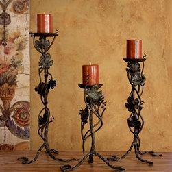 Vineyard Candlesticks (Set of 3) - Grapevines gracefully climbing the wrought iron stands set off candles of your choosing. Enhance the atmosphere of your living room, dining room or bedroom with this set of three hand forged candlestick holders.