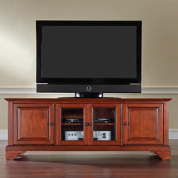 """Crosley - LaFayette 60"""" TV Stand - Enhance your living space with Crosley's impeccably-crafted Low Profile TV stand. This signature cabinet accommodates most 60"""" flat panel TVs, and is handsomely proportioned featuring character-rich details sure to impress. Perfect for blending with the family of furniture that is already part of your home. Panel doors strategically conceal stacks of CD/DVDs, and various media paraphernalia. Tempered glass doors not only add a touch of class; they protect those valued electronic components, while allowing for complete use of remote controls. Adjustable shelving offers an abundance of versatility to effortlessly organize by design, while cord management tames the unsightly mess of tangled wires. Style, function, and quality make this cabinet a wise choice for your home furnishings needs. Features: -LaFayette collection. -Solid hardwood and veneer construction. -Wire management. -Beautiful raised panel doors. -Three adjustable shelves. -Beveled tempered glass. -Adjustable levelers in legs. -Accommodates most 60"""" TVs. -ISTA 3A certified. -Manufacturer provides 3 months limited warranty."""