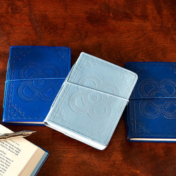 Indigo Embossed Leather Journal - Navy - Within their pages may lie passages that recall the adventures of a faraway journey, the pleasures of a summer idyll passed along the shore, or the daily details of joyous childhood. The Indigo Set of 3 Embossed Leather Journals boasts handsomely bound journals in three colors: navy, slate, and royal blue. The handmade, unlined paper lends each journal an heirloom quality.