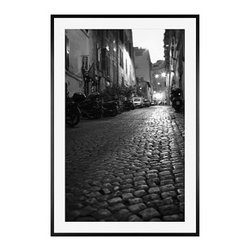 """Michal Venera Framed Print, Streets of Rome II, Mat, 28 x 42"""", Black - On first glance, these iconic images of Rome are striking for their lush sepia tones, rich detail and intriguing camera angles. A closer look reveals the beauty of patterns, whether it is hundreds of stones that make up an old street, arches in the coliseum or the remaining three columns of a ruin. All exude a sense of order and timelessness amid the ever-changing landscape of city and country. 11"""" wide x 13"""" high 16"""" wide x 20"""" high 28"""" wide x 42"""" high Alder wood frame. Black or white painted finish; or espresso stained finish. Beveled white mat is archival quality and acid-free. Available with or without a mat.{{link path='shop/accessories-decor/pb-artist-gallery/artist-gallery-michal-venera/'}}Get to know Michal Venera.{{/link}}"""