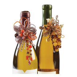 "Grandin Road - Wine Jewelry - Each 2-1/2"" ring slips perfectly over a bottleneck or around a napkin. Select from two designs: Harvest or Grapes. Harvest features orange, brown, and metallic resin beads on a wire base. Grapes combines golden- and amber-hued glass beads with a wire and brass base. Dress up your favorite vintage with our sparkling wine jewelry. Give one as a gift with a great bottle of vino, or garnish the bottles on your own bar.  .  .  .  ."