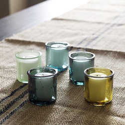 Recycled-Glass Votive Holders - The color palette of these candle holders are so beautiful and they go really well with the palette of this outdoor living space. I'm really loving these greens and blues lately.