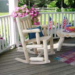 Rustic Natural Cedar Furniture Harvest Family Porch Rocker - The Harvest Family Porch Rocker is a charming addition to your porch or deck sure to bring the feel of rustic cabin living home. This rocking chair is crafted almost entirely from whole unfinished northern white cedar logs giving it a true handmade look. The rocker blades are also of cedar finely tooled and shaped to provide an easy rocking motion and the seat is of smooth cedar planks. Though cedar is beautiful in its unfinished form the rocker can be stained sealed or painted after purchase to fit your specific needs. Since cedar is naturally pest- and rot-resistant it is ideal for outdoor use.About Rustic Natural Cedar Furniture Co.Rustic Natural Cedar Furniture Company has been manufacturing quality cedar products for your home and garden for over 30 years. Their broad variety of products include bedroom sets tables and seating groups gliders rockers swings arbors and more. Their fine furnishings are handcrafted in Quebec and British Columbia then shipped worldwide for your enjoyment. The Rustic Natural brand is their promise. When you see this brand you know you're getting superior quality and the strength of natural cedar. Nothing equals the sturdy construction and sanded finish of their quality products. Long-lasting good looks and low maintenance makes cedar the natural choice for your home and garden. Thanks to its added benefits of beauty and comfort cedar is an ideal choice for any setting.