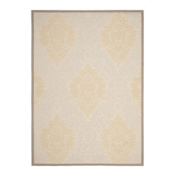 Safavieh - Poolside Beige/Dark Beige Indoor/Outdoor Polypropylene Rug (6'7 x 9'6) - Update your patio or deck with this stylish indoor-outdoor area rug. The beige color will coordinate with a wide range of decors and furnishings, and it is constructed of heavy-duty polypropylene, which helps it to withstand the elements.