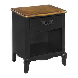 HomeStyles - Oak and Rubbed Black Night Stand - The night stand is constructed of hardwood solids, engineered wood and oak veneers in a distressed oak and heavily rubbed black finish. The distressed oak features several distressing techniques such as worm holes, fly specking, and small indentations. Features include one storage drawer and one bottom shelf. Design features include shaped carved proud legs, raised corner peg accents, and detailed brass hardware. Assembly required. 23.75 in. W x 18 in. D x 28 in. H