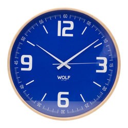 "Wolf Designs - 21"" Wall Clock - Keep perfect time with this cool, contemporary wall clock. Encircled in a wood frame, the 21-inch dial and bold numbers make it a cinch to read, while its minimal design and selection of stylish colors make it a chic way to complement your decor."