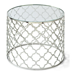 Kathy Kuo Home - Heston Hollywood Regency Silver Beveled Glass Round End Table - The open architecture of this delicate, silver side table makes it modern, while the quatrefoil shape repeated in the base evokes Gothic design. A round glass top reflects objects above and below, creating a uniquely elegant accent for any area.