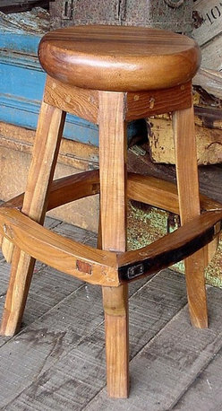 """Groovy Stuff - Backless Teak Barstool with Footrest - The Backless Teak Barstool with Footrest stands 30"""" tall and features a round 18"""" diameter seat.  This ruggedly handsome barstool is crafted from reclaimed Teak wood and displays a rich, antique finish that will complement any indoor or outdoor entertainment setting!  Featuring an exquisitely radiant Teak composition, this incredible Trigger seat provides a smooth and comfortable stool seat over a sturdy and unique four-legged construction that is ringed by a broad and distinctive food rest.  This stool made of quality Teak offers the ultimate in country or rustic style.  An innovative footrest is placed along the outside of the legs, making this chair exceptional and far from commonplace. * The Backless Teak Barstool with Footrest stands 30"""" tall and features a round 18"""" diameter seat. This ruggedly handsome barstool is crafted from reclaimed Teak wood and displays a rich, antique finish that will complement any indoor or outdoor entertainment setting!. LxWxH: 18""""L x 18""""W x 30""""H. Reclaimed teakwood furniture creates this great rustic look. Bring a bygone era of farm plows & wagons to your home or business. Each unique piece is suited for both indoor and outdoor use. Please Note: Due to the unique nature of each piece of wood and the materials used, no two items are exactly alike. These items can vary in dimension, weight and color from the shown image and the listed information"""