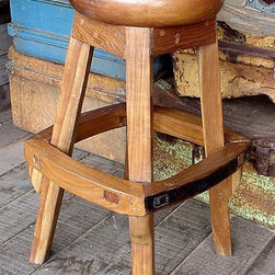 "Groovy Stuff - Backless Teak Barstool with Footrest - The Backless Teak Barstool with Footrest stands 30"" tall and features a round 18"" diameter seat.  This ruggedly handsome barstool is crafted from reclaimed Teak wood and displays a rich, antique finish that will complement any indoor or outdoor entertainment setting!  Featuring an exquisitely radiant Teak composition, this incredible Trigger seat provides a smooth and comfortable stool seat over a sturdy and unique four-legged construction that is ringed by a broad and distinctive food rest.  This stool made of quality Teak offers the ultimate in country or rustic style.  An innovative footrest is placed along the outside of the legs, making this chair exceptional and far from commonplace. * The Backless Teak Barstool with Footrest stands 30"" tall and features a round 18"" diameter seat. This ruggedly handsome barstool is crafted from reclaimed Teak wood and displays a rich, antique finish that will complement any indoor or outdoor entertainment setting!. LxWxH: 18""L x 18""W x 30""H. Reclaimed teakwood furniture creates this great rustic look. Bring a bygone era of farm plows & wagons to your home or business. Each unique piece is suited for both indoor and outdoor use. Please Note: Due to the unique nature of each piece of wood and the materials used, no two items are exactly alike. These items can vary in dimension, weight and color from the shown image and the listed information"