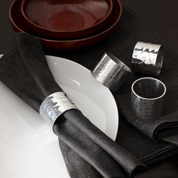 Hammered Metal Napkin Ring - Metal mania. Hammered aluminum napkin rings light up the table with rich texture.
