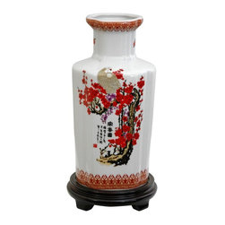"Oriental Furniture - 12"" Cherry Blossom Porcelain Vase - High-shouldered hexagonal vase, a shape popular in both Japanese and Chinese home decor. Decorated with vivid red cherry blossoms, white cranes, and authentic black Chinese calligraphy characters on a white china background. Display on its own on a stand or curio cabinet, or filled with flowers or bamboo."