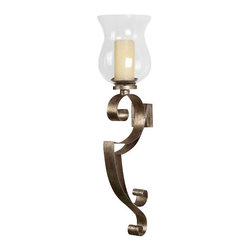 Uttermost Loran Metal Wall Sconce - Heavily antiqued silver champagne with a clear glass globe. Beige candle included. Hand forged metal sconce finished in heavily antiqued silver champagne with a clear glass globe. Beige candle included.