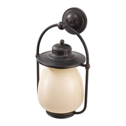 Murray Feiss - Murray Feiss OL9304GBZ Mc Coy 20 5 High 1 Light Outdoor Wall LanternDockyard Col - As its name suggests the Dockyard outdoor lighting collection is nautically inspired.  The details of the Oil Can finish on the hardware and cage design, along with the decorative ripple in the White Opal Etched glass shade all hark back to the light fixtures seen in harbors and lighthouses of yesterday.