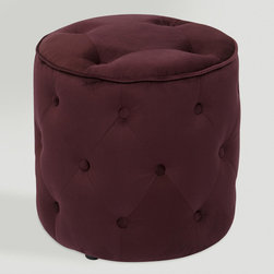 World Market - Port Tufted Velvet Ottoman - Our Port Tufted Velvet Ottoman offers a plush place to put your feet up for total relaxation in absolute style! Inspired by antique tufted furniture, this durable round ottoman features eye-catching tufted buttons with piping details. Upholstered in a high performance, easy-care fabric with a luscious purple hue, this classic ottoman is perfect extra seating for guests.